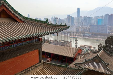 Large contrast between chinese city with skyscrapers and shrine