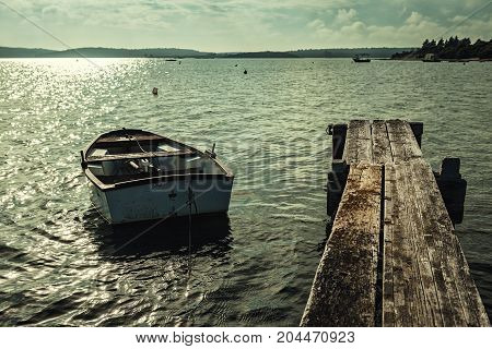 Small boat in vintage colors closeup photo