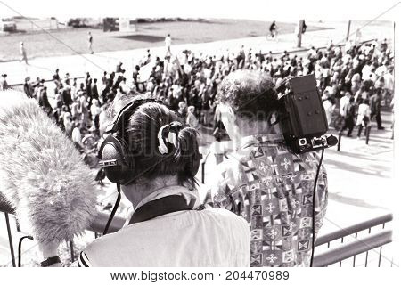 MAGDEBURG, GERMANY - ca. 1994: Journalists filming and photographing in Magdeburg a demonstration against racism.
