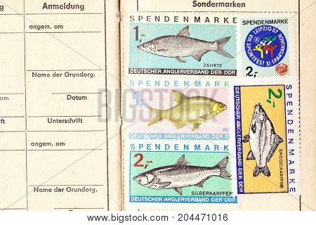 GERMANY, GDR - circa 1985: Special stamps in the membership certificate of the GDR fishing association.