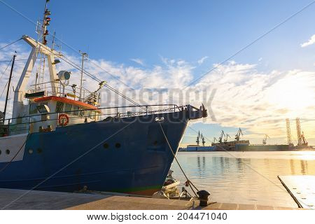 Fishing boat at the dock with sunset