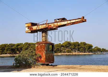 Old tap on the beach / Old crane for boats