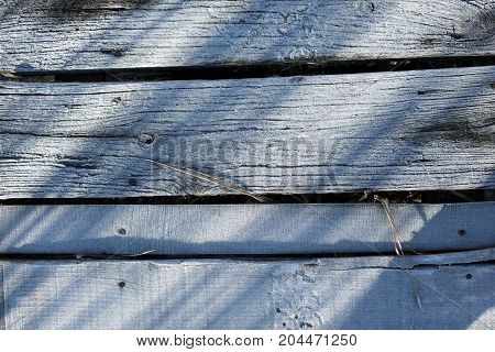 Wooden deck covered by ice crystals closeup photo