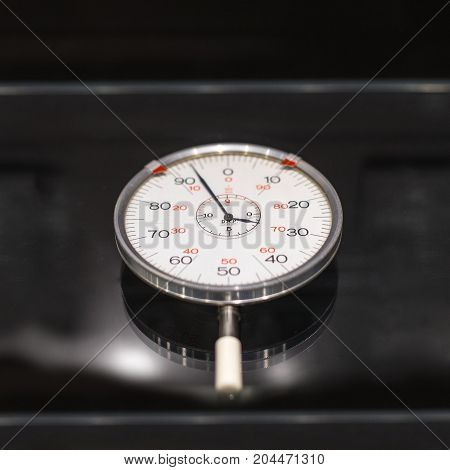 Industrial measurement device closeup on dark background