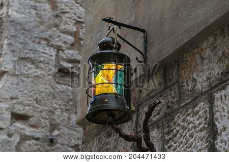Color street lamp / street lamp on the wall of the house