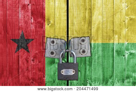 Guinea Bissau flag on door with padlock