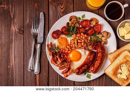 Traditional Full English Breakfast With Fried Eggs, Sausages, Beans, Mushrooms, Grilled Tomatoes And