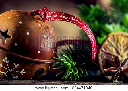 Christmas. Jingle Bell Christmas Decorations And Ribbon With Text Happy Christmas