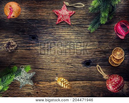 Christmas. Christmas Composition Fir Branches Pine Cones Jingle Bells Stars And Ribbon On Rustic Woo