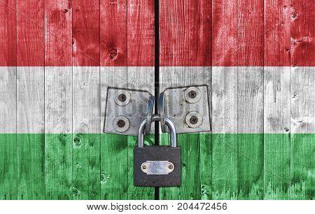 Hungary flag on door with padlock close