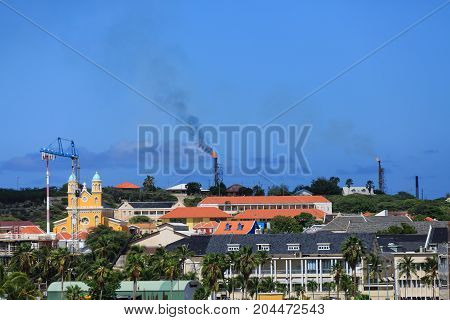 Oil Rigs Burning on Curacao beyond tourist attractions and resorts