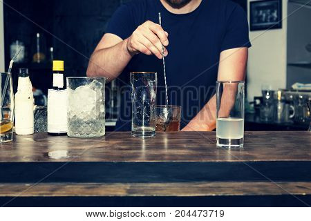 The barman is preparing a cocktail at the bar winter holiday