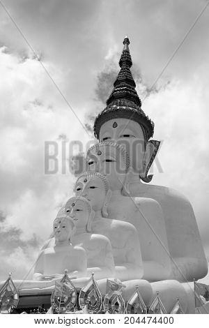 black and white tone of multiple of buddha statue overlapping in the public temple in Thailand