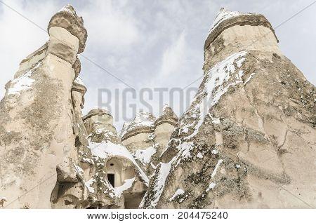 Unique Geological Rock Formations Under Snow In Cappadocia, Turkey.