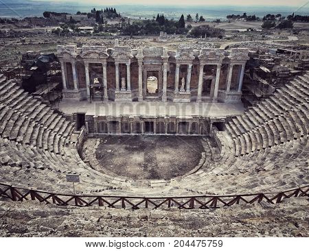 DENIZLI CITY, TURKEY - AUGUST 2016: Roman Theatre is located in the middle of Hierapolis in Denizli Turkey. It was built in 2nd century AD. Roman Theatre had a capacity of aprox. 10.000 spectators.