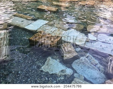 DENIZLI CITY, TURKEY - AUGUST 2016: Cleopatra's Pool that also called the Pamukkale Antique Pool. According to legend this artificially sculpted pool was a gift from Marc Anthony to Cleopatra.