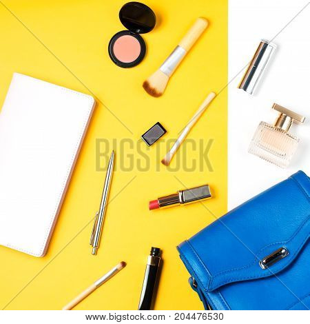 Fashion blogger objects flat lay. Beauty products and stylish female accessories on pastel background, top view.