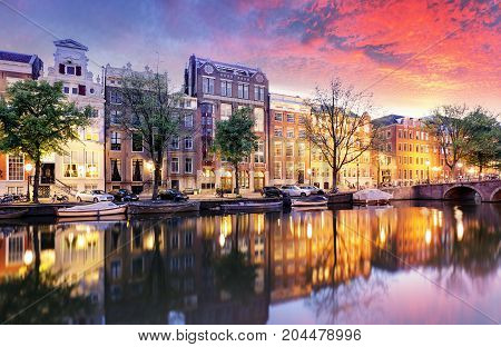 Sunset city view of Amsterdam the Netherlands with Amstel river