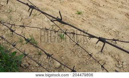 Fence with barbed wire at the border on the Stalin line during the first world war