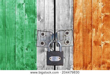 Ireland flag on door with padlock close