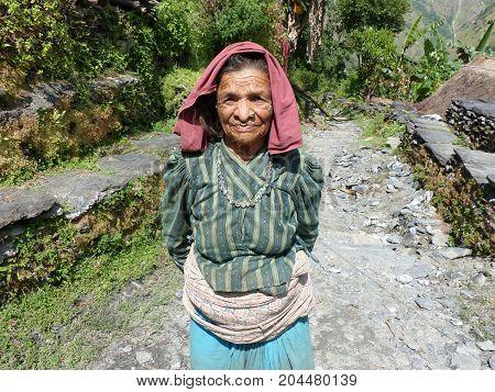 Old nepalese woman Tatopani, Nepal, september 28, 2015: Old Nepalese woman, Meeting local people during Annapurna Circuit Trek in Nepal