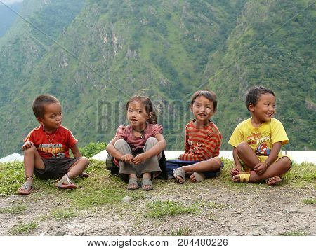 Nepalese children Tallo Chipla, Nepal, september 21, 2014: Children from Tallo Chipla village, Meeting local people in Nepal during Annapurna Circuit trek