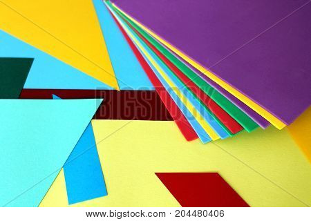 Colored sheets of paper lying in disorder.Holiday of colors.