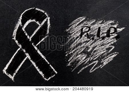 White chalk drawing as black ribbon shape on black board background (Concept for symbol of remembrance or mourning)