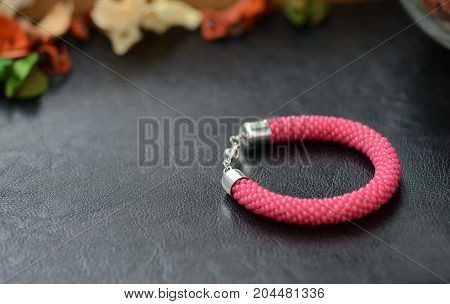 Bead Crochet Bracelet Red Color On A Dark Background