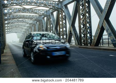 Cars Driving On The Asphalt Road Of The City Bridge On A Foggy Day In Dieppe, France. Metal Structur