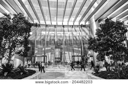 BRISBANE, AUSTRALIA - AUGUST 31 2017: 1 William Street front entrance, with business people walking about. Black and White
