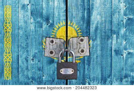 Kazakhstan flag on door with padlock close