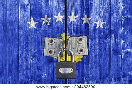 Kosovo flag on door with padlock close