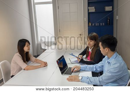 Interviewers review the CV of candidate before start to interview