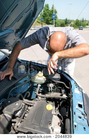 Businessman Checking The Engine Of A Car
