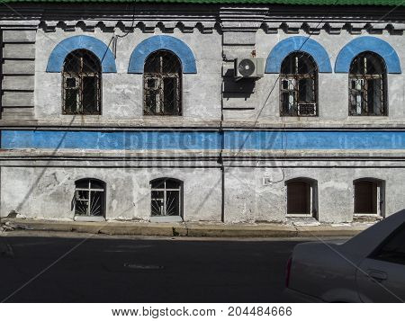 Very old building in one of the streets of Ust-Kamenogorsk. Old Architecture