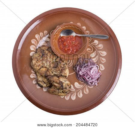 Pork steak with tomato sauce and red onion. Isolated on a white background.
