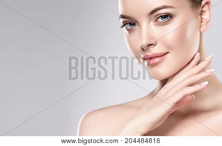 Beautiful Young Woman with Clean Fresh Skin . Facial  treatment   . Cosmetology , beauty  and spa .  Skin care