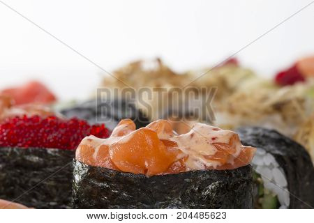 Set of delicious gunkans sushi. Gunkans with salmon and red robiko caviar. Macro. Photo can be used as a whole background.