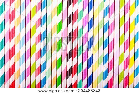 Colored striped drink straws top view background