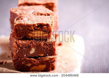 Hazelnut and white chocolate brownies on board