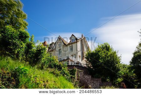 Country House With Green Garden In The Region Of Normandy, France On A Sunny Day. Beautiful Countrys