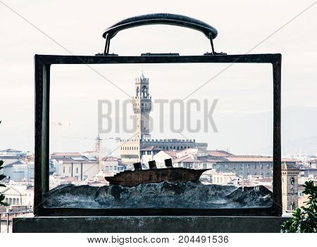 View of the Palazzo Vecchio through the metal frame with the boat Florence Tuscany Italy. Travel destination. Old photo filter.