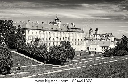 Famous manor and Church of the assumption of the Mary Valtice southern Moravia Czech republic. Architectural scene. Travel destination. Black and white photo.