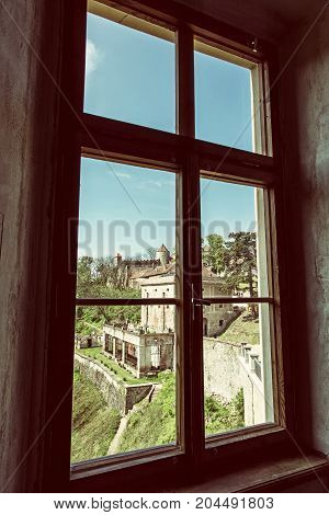 Veveri castle Moravia Czech republic. View from window. Ancient architecture. Travel destination. Retro photo filter.