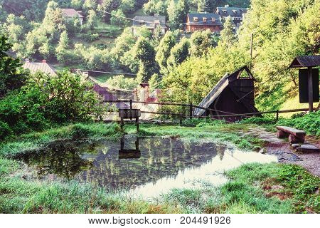 Mountain lake and country houses in the village Spania Dolina Slovak republic. Travel destination. Beauty photo filter.