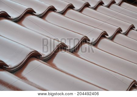roof covered with red ceramic tile, evenly laid