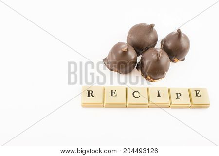 candy and chocolate cones and ''recipe'' written with chips. White background.