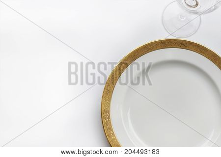 Porcelain golden plate on a white background