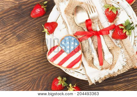Tableware And Silverware With Heart Shaped Cookie With American Flag, Wooden Background, Top View